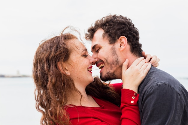 Happy couple hugging on sea shore