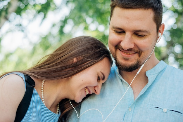 Happy couple listening to music
