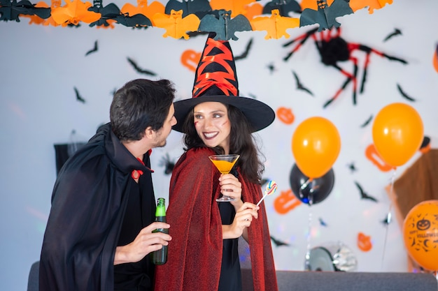 Happy couple of love  in costumes and makeup on a celebration of halloween