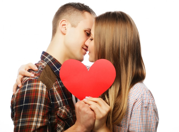 Happy couple in love holding red heart.
