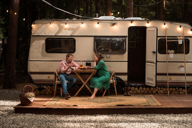 Happy couple in love living in trailer at summer