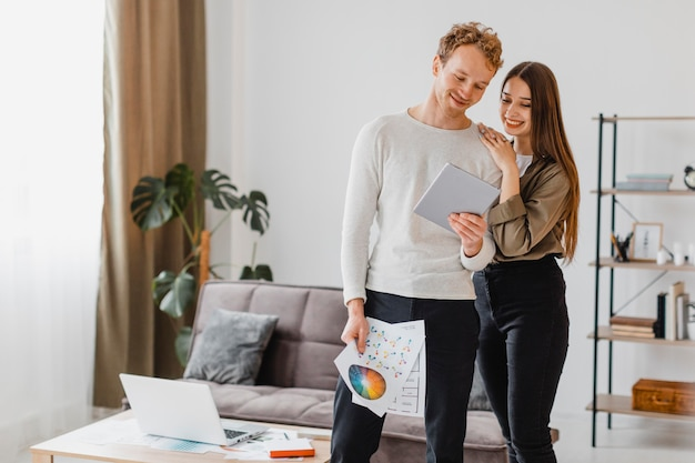 Happy couple making plans to recondition the home together