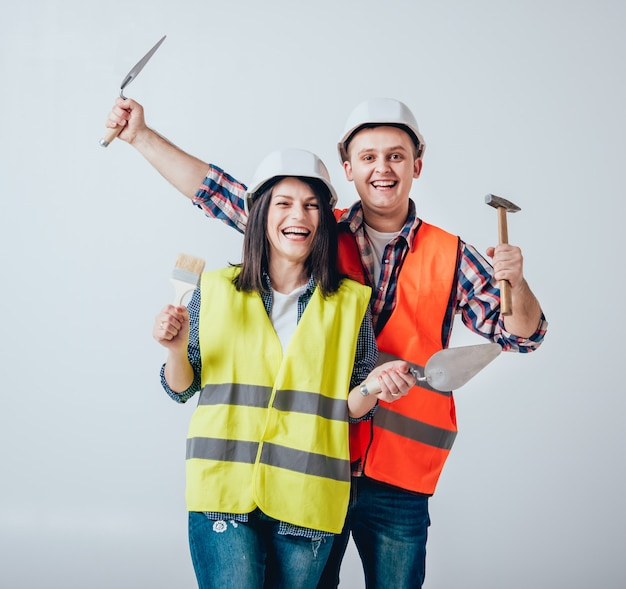 Happy couple making repairs to their home.