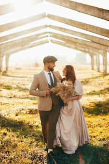 Happy couple. married loving hipster couple in wedding dress and suit walking. wedding ceremony