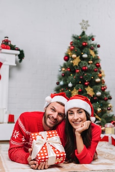 Happy couple near christmas tree