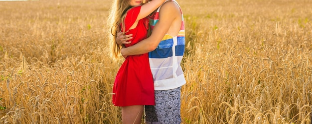 Happy couple outdoor, summertime. young loving couple in field