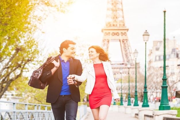 Happy couple in paris with eiffel tower
