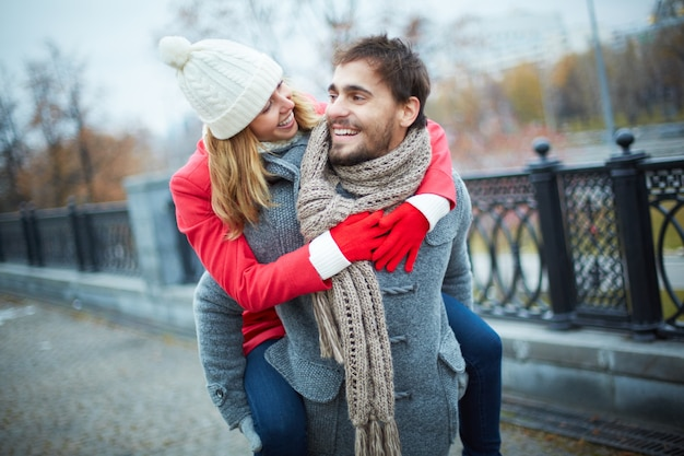 Happy couple piggybacking