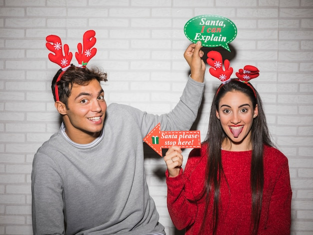 Happy couple posing with christmas stickers