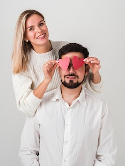 Happy couple posing with hearts on eyes