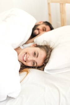 Happy couple relaxing on bed