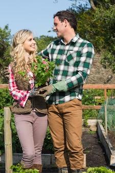 Happy couple standing in the garden