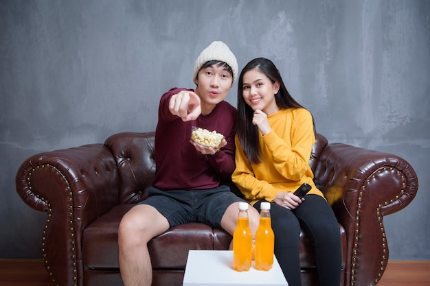 Happy couple stay at home watching movies