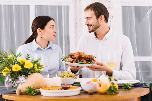 Happy couple talking at festive table