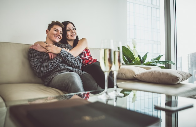 Happy couple in their new expensive apartment
