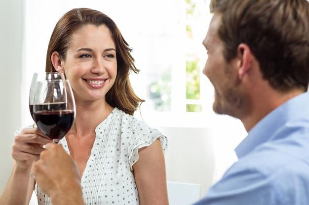 Happy couple toasting wineglasses
