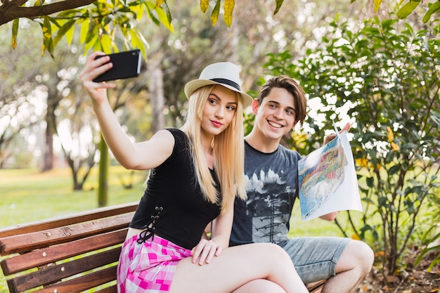 Happy couple of tourists making a selfie.