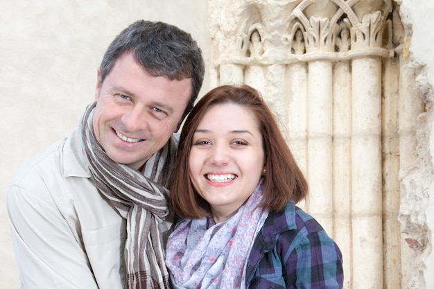 Happy couple of tourists on vacations in europe italy and french travel