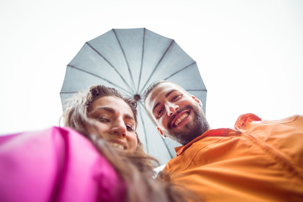 Happy couple under an umbrella