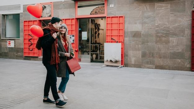 Happy couple walking down street
