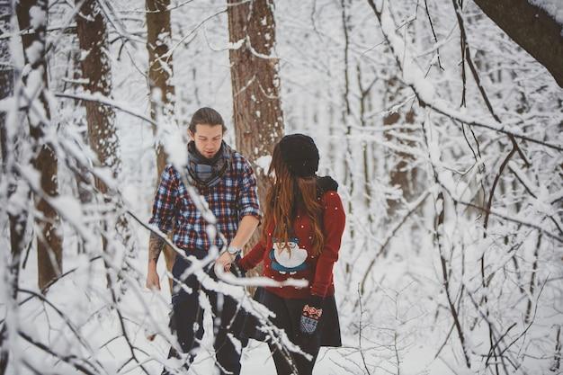 Happy couple walking in winter park