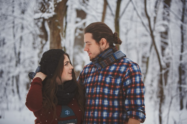 Happy couple in the winter forest