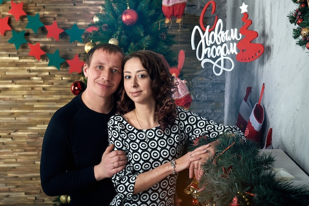 Happy couple with christmas decorations