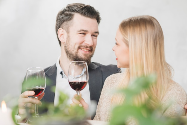 Happy couple with glasses of red wine