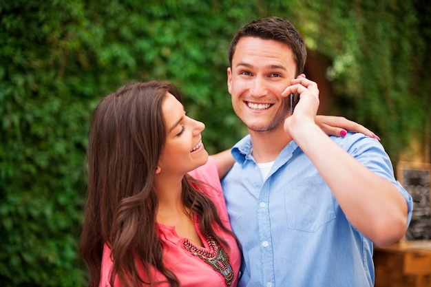 Happy couple with mobile phone
