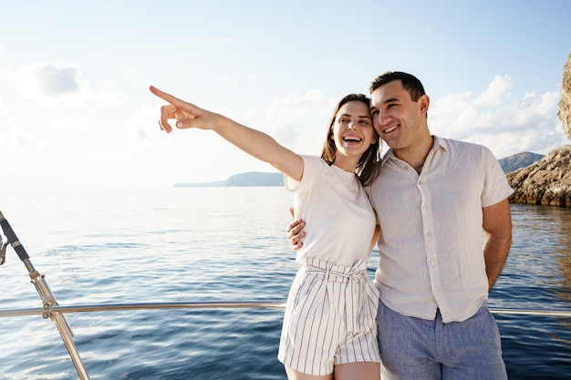 Happy couple on a yacht in summer on romantic vacation