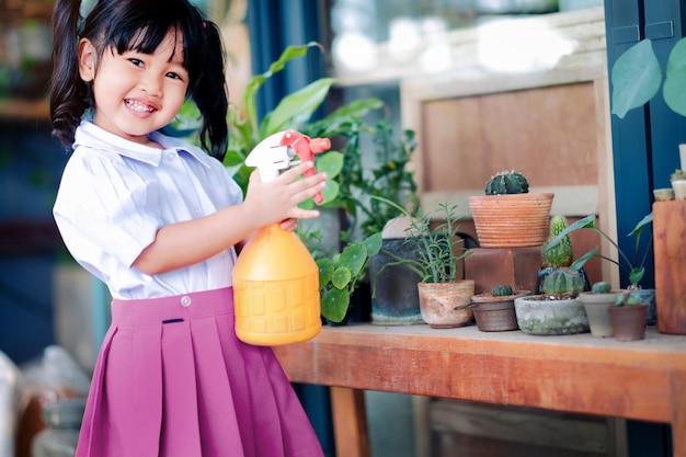 Happy cute asian girl enjoying with gardening activities