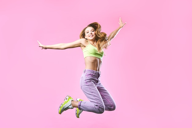 Happy cute girl is jumping up, in summer outfit