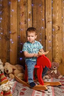 Happy cute little baby boy on rocking horse