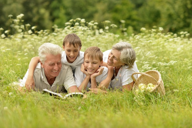 Happy cute smiling family in summer forest
