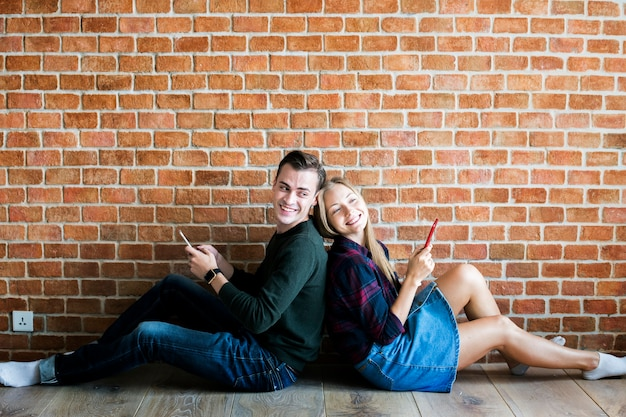 Happy cute young couple using a smartphone