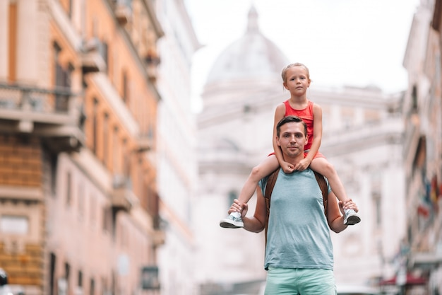 Happy dad and little adorable girl traveling in rome, italy