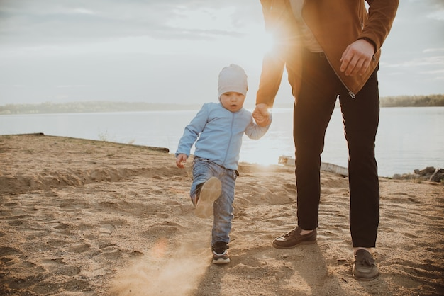 Happy dad and son playing on a beach