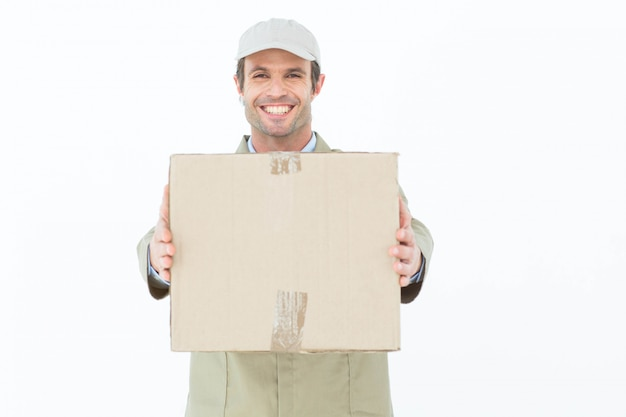 Happy delivery man carrying parcel