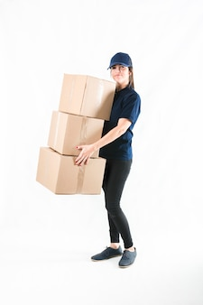 Happy delivery woman holding stacked of parcel