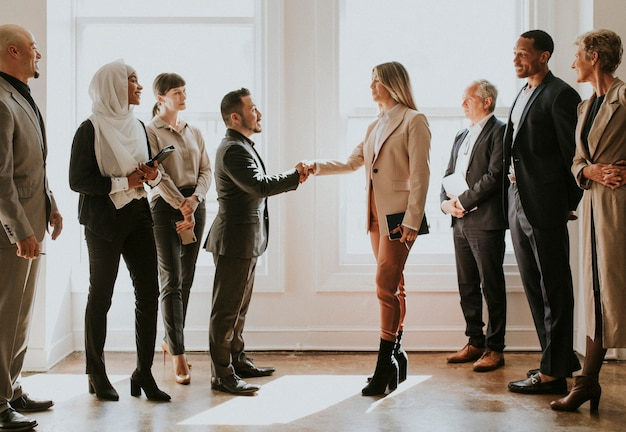 Happy diverse business people making a deal