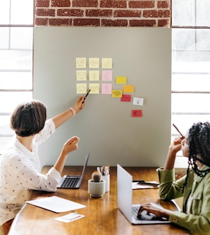 Happy diverse businesswoman brainstorming ideas