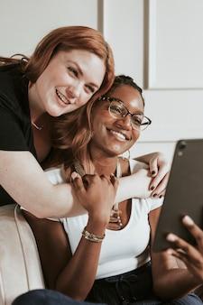 Happy diverse women taking a selfie