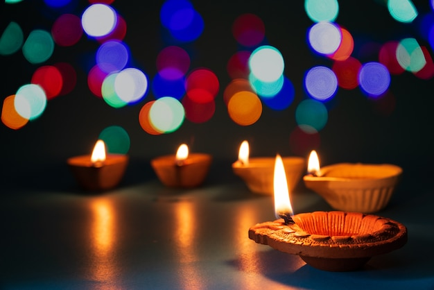 Happy diwali - clay diya lamps lit during dipavali, hindu festival of lights celebration.