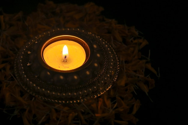 Happy diwali lit candle top view