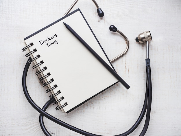 Happy doctor's day. beautiful card. notebook with congratulatory inscription
