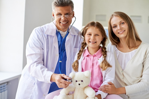 Happy doctor with his patients