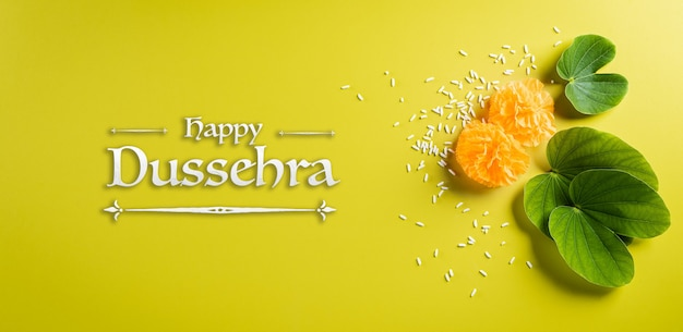 Happy dussehra background concept. green leaf and rice