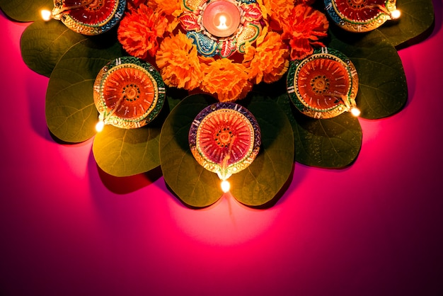 Happy dussehra. clay diya lamps lit during dussehra, indian festival concept.