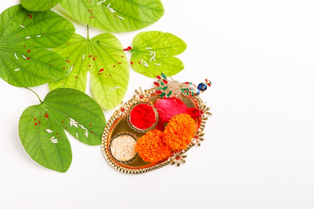 Happy dussehra with green leaf, rice and kumkum decorate in plate