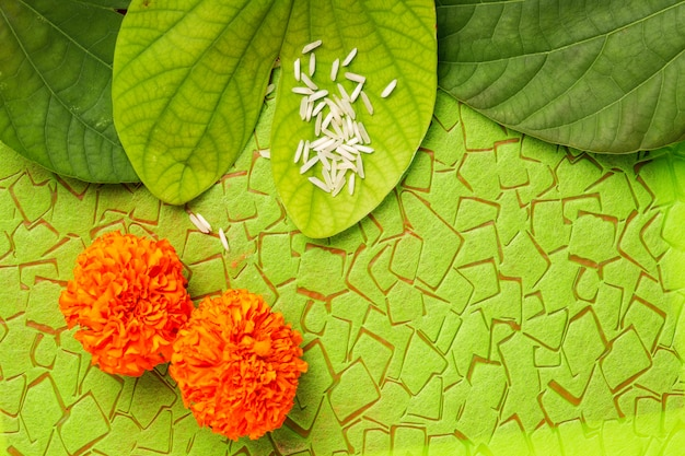 Happy dussehra with green leaf and rice